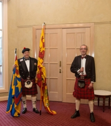 Clifford Wolf holding the standards of the Chief of Clan MacNeacail and the Baron of Balvenie with Neil Nicoll    -    20121013 - Clan MacNicol Céilidh -Launceston, Tasmania, Australia